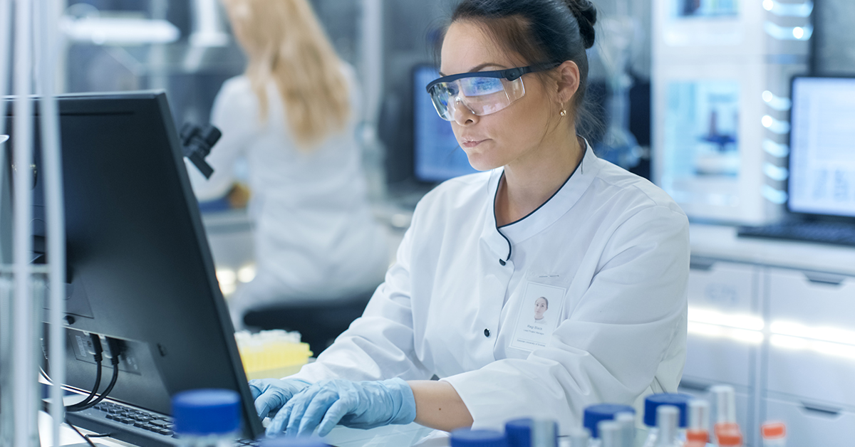 Scientist in lab reading data