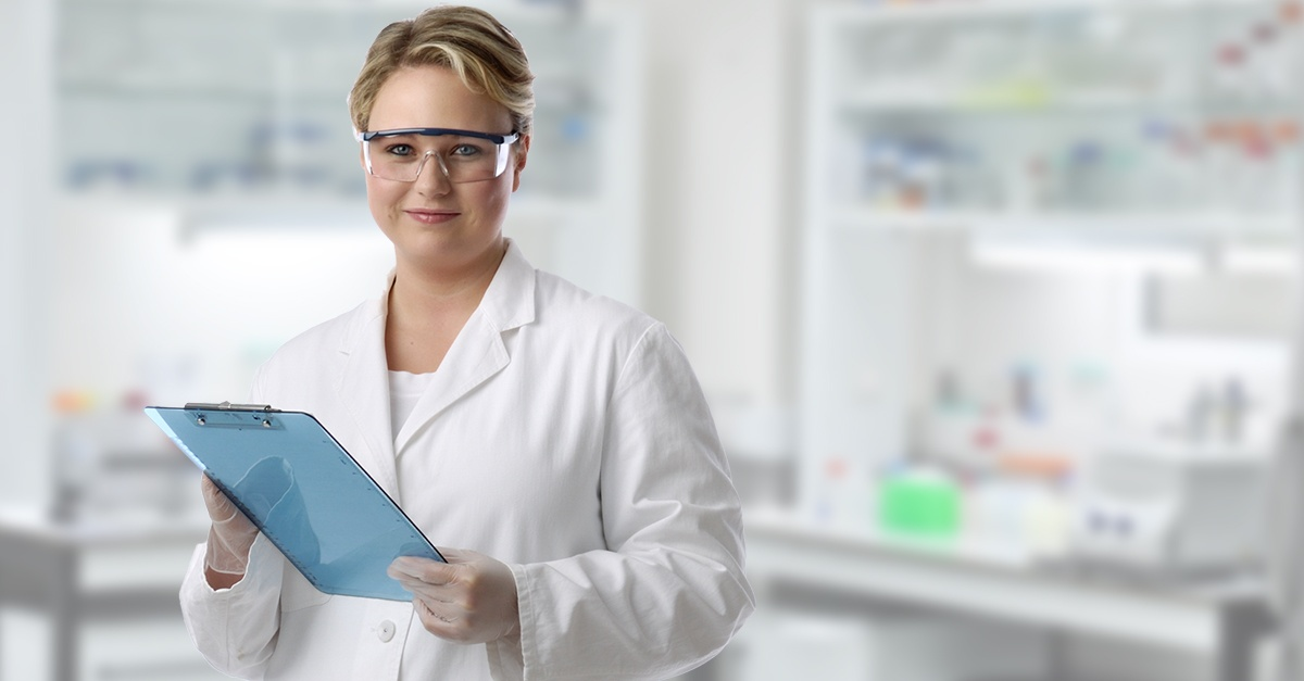 Scientist in lab with clipboard
