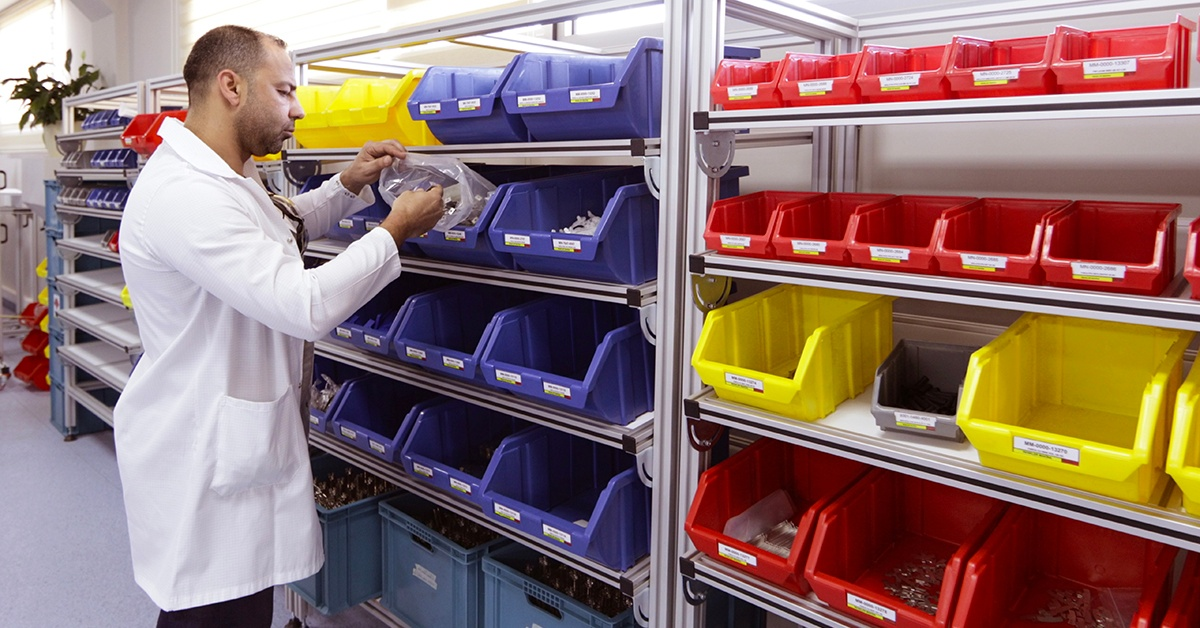 Lab technician looking through supply boxes